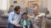 three generation : Happy grandfather enjoying pastime with his son and grandson, slow-motion