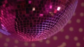 rave : Mirror disco ball rotating in nightclub lights, festive party atmosphere, fun