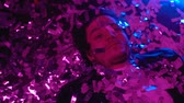 estilos de vida : Drunk man sleeping on floor in night club covered with confetti, party hangover