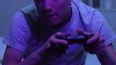 hombres : Gamer playing video game using joystick at night instead of sleeping, addiction Archivo de Video