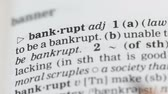 gramática : Bankrupt word in english dictionary pointed with pencil, market failure collapse
