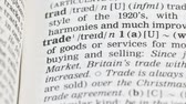 dilbilgisi : Trade, pencil pointing word on vocabulary page in english, global economics Stok Video