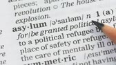 immigrants : Asylum, pencil pointing word on vocabulary in english, safe place for staying Stock Footage