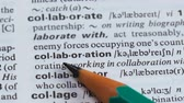 dilbilgisi : Collaboration word definition pointed in dictionary, mutual project, cooperation Stok Video