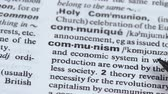 книги : Communism definition pointed in vocabulary, political and economic system, state Стоковые видеозаписи