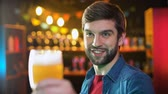 cerveza artesanal : Handsome bearded male clinking beer glasses with friend, weekend results in pub