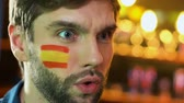 rugby : Spanish male fan making facepalm gesture, upset about favorite team losing game Stock Footage