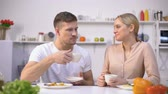 the digestion : Attractive couple drinking tea after meal for better digestion, water balance Stock Footage
