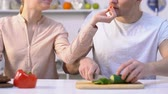 casal : Girlfriend feeding boyfriend cooking fresh salad romantic relationship in couple