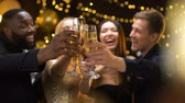 clinking : Cheerful multi-racial friends clinking champagne glasses, corporate event, fun