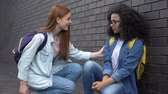 segít : Smiling college student encouraging new classmate taking hand, help assistance