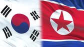 espião : South Korea and North Korea officials exchanging confidential envelope, flags