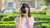 trio : Female photographer taking photos with camera in park, lessons for beginners