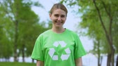 çöp : Pretty caucasian woman recycling sign t-shirt smiling camera, natural resources