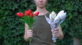 тюльпаны : Woman showing handmade textile bunch of flowers to camera, reuse of cloth