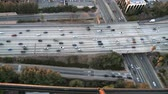 grade : Aerial footage of Los Angeles freeways and suburbs.