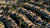 wealthy : Aerial footage of housing development that appears in the opening credits of Weeds.