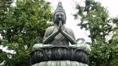statue : Zoom Out of Statue of Buddha at Sensoji Temple  -  Tokyo Japan