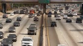 warming : Zoom Out  Overhead View of Traffic on Busy Freeway in Downtown Los Angeles California