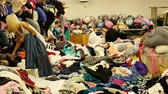остатки : Pan of Asian Women Sorting through Fabrics at LA Fabric Mart