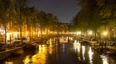 Time Lapse -  Boat Cruising Down Canal at Night  - Amsterdam Netherlands