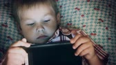 Close-up of boy face looking at tablet computer Stock mozgókép