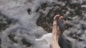 ayak parmağı : Man walking bare foot on sandy beach into sea wave Stok Video
