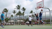 Young males playing basketball Hawaii Maui, November 2016 Стоковые видеозаписи