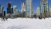 Fresh snow blue sky highrise buildings playground