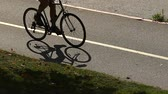 Slow motion silhouette bicyclist moving road