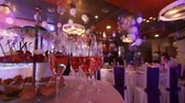 waiter : The waiter pours champagne in wineglass, in a restaurant, The waiter pours champagne in crystal glasses, Restaurant interior, buffet table, Waiter in white gloves, close-up