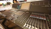 itme : Professional audio console in a concert, sound mixer console during a concert, audio Mixer, control engineer, selective focus, audio mixer, shallow depth of field Stok Video