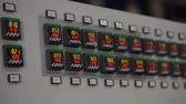 itme : control panel in the factory, control buttons. modern plant, man buys buttons, close-up, interior, indoors Stok Video