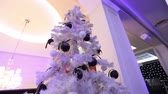ziyafet : large Christmas tree in the lobby of the hotel, restaurant. Christmas tree in the hall on the background of the marble staircase with a handrail, bottom view Stok Video