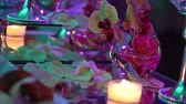 dining table : Decorative candles on the dining table, glasses and Christmas candles on the table, white wax candleswith glass candlestick, Candle with Glass Candlestick, restaurant, interior, close-up Stock Footage