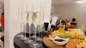white wine dish : glasses with champagne and fruits on buffet table, buffet table at a restaurant or in the hotel lobby, the camera along, shallow depth of field, welcoming guests in the lobby of the restaurant