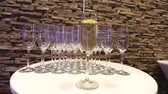waiter : Champagne in wineglass, in a restaurant, Restaurant interior, buffet table, close-up