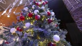 shallow depth field : large Christmas tree in the lobby of the hotel, restaurant. Christmas tree in the hall on the background of the marble staircase with a handrail, bottom view Stock Footage
