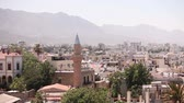 moslem : View of the Arab city by a mosque, The Arab city near the sea, the minaret in the Arab city, the Muslim, the Muslim city, east, Arabian town near the sea, against the backdrop of mountains, top view Stock Footage