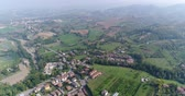 mavic : a small ancient Italian city, an Italian village from the air, a road in the mountains