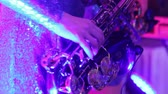 saxophone : A girl with a saxophone, a musical group of girls with a saxophone perform on stage, a blue dress, a stage light, a movement, closeup, nightclub, restaurant Stock Footage