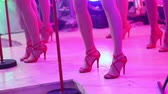 saxophone : A female music band performs on stage, Beautiful Girls with saxophones on stage. Girl playing saxophone, beautiful female feet, womens legs in red high-heeled shoes