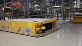 vezetett : Industrial interior, modern factory interior, Electrical Automated Guided Vehicles Platform, close-up Stock mozgókép