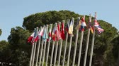 sacred festival : Colourful flags swaying against a blue sky, Many flags sway in the wind