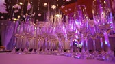 waiter : Empty glasses for champagne on the buffet table in the restaurant hall, buffet table, restaurant interior, glasses for champagne Stock Footage