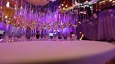 waiter : Glasses with champagne on the table in the restaurant, glasses of champagne on festive table, Clean glasses on a table prepared by the bartender for champagne and wine Stock Footage