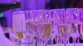 waiter : Glasses with champagne on the buffet table in the restaurant hall, a shurshetny table with glasses and champagne in the restaurant, shallow depth of field
