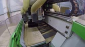 processado : Automatic woodworking machine cuts out details on a wooden panel, Routing Edgebanding Nesting Woodworking Machine, industrial interior, modern woodworking machine, close-up, timelapse