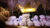 muçulmano : Teddy bears sitting in a row, white teddy bears, helium balloons, cute teddy bear with a butterfly on her neck, soft toy, Interior halls for childrens birthday, a gift, a room, indoors, Teddy bear