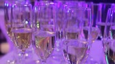 several : Glasses with champagne on the buffet table in the restaurant hall, a shurshetny table with glasses and champagne in the restaurant, shallow depth of field